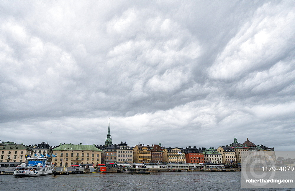 Storm clouds over the historic buildings of Gamla Stan by the sea, Stockholm, Sweden