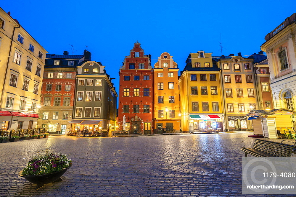 Illuminated historic buildings at dusk, Stortorget Square, Gamla Stan, Stockholm, Sweden
