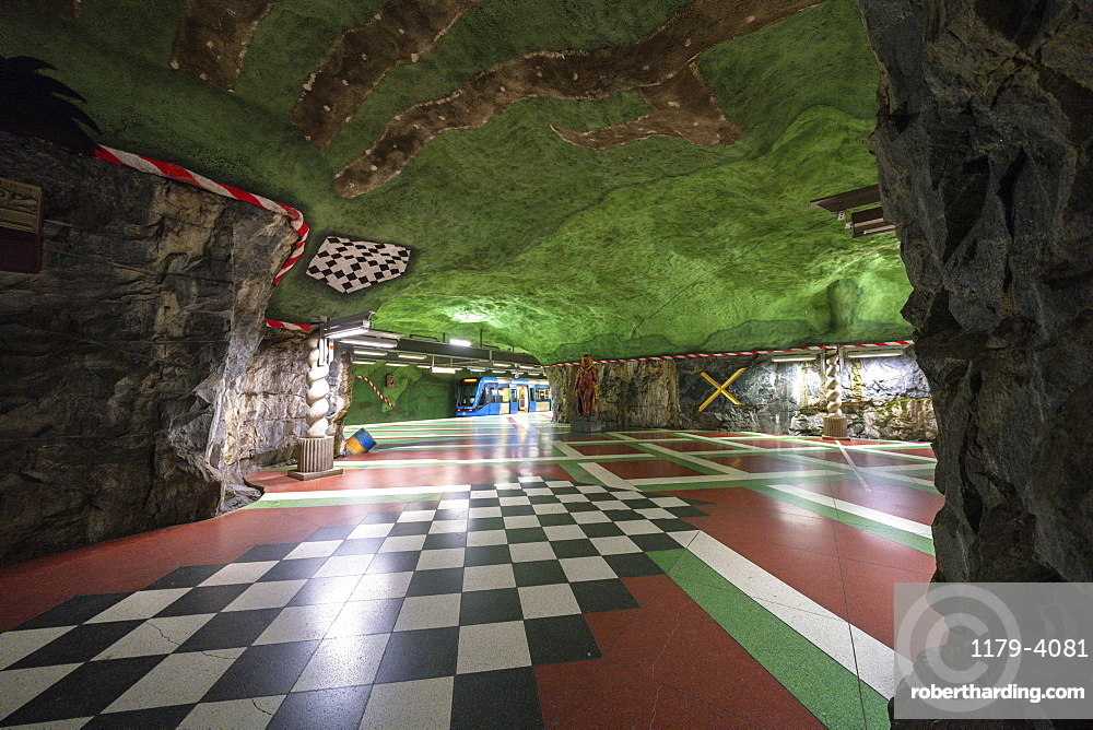 Kungstradgarden Metro station, hewn into the bedrock and painted with vibrant colors represent the ecosystem, Stockholm, Sweden
