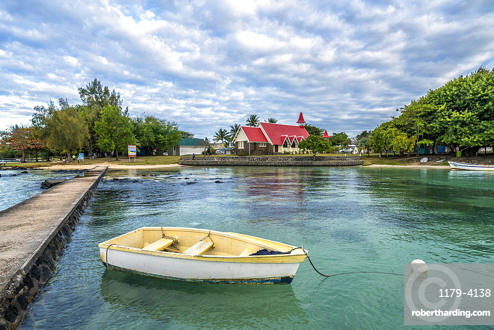 Boat moored in the sea surrounding the Notre Dame Auxiliatrice Church, Cap Malheureux, Mauritius, Indian Ocean, Africa