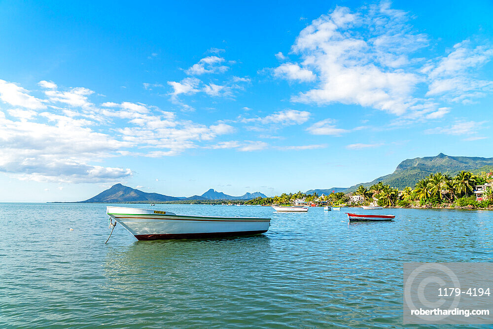 Fishing boats moored in the tropical lagoon, La Gaulette, Black River district, Mauritius, Indian Ocean, Africa