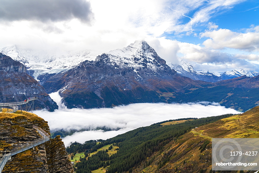 People admiring Mount Eiger from First Cliff Walk elevated walkway, Grindelwald, Bernese Oberland, Canton of Bern, Switzerland