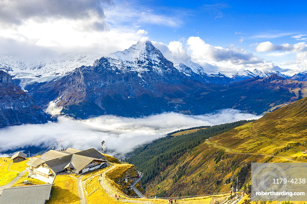 Hikers admiring the autumn landscape from elevated walkway (Cliff Walk by Tissot), First, Grindelwald, Canton Bern, Switzerland