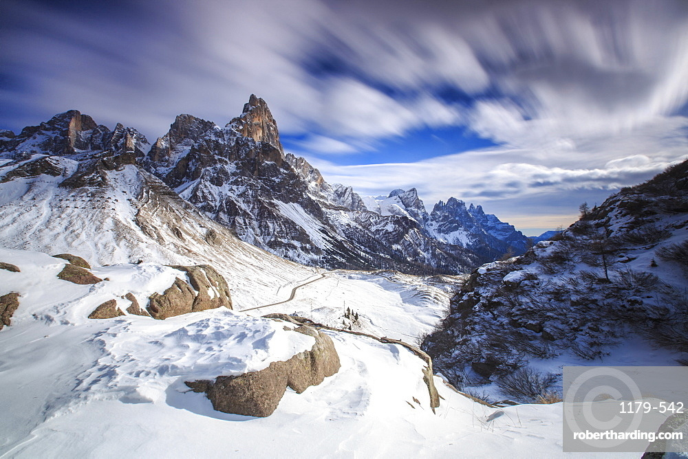 Cloudy winter sky on the snowy peaks of the Pale di San Martino, Rolle Pass, Panaveggio, Dolomites, Trentino-Alto Adige, Italy, Europe