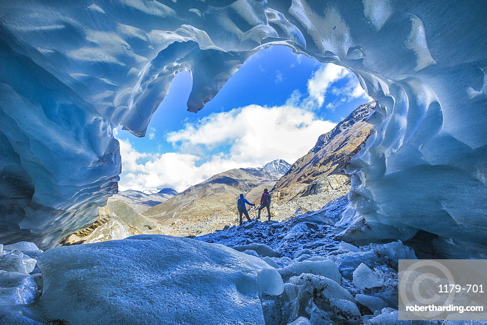 Hikers inside Forni Glacier, Forni Valley, Stelvio National Park, Valtellina, Lombardy, Italy, Europe