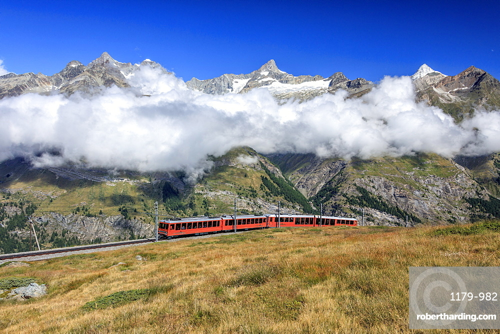The Bahn train on its route with high peaks and mountain range in the background, Gornergrat, Canton of Valais, Swiss Alps, Switzerland, Europe