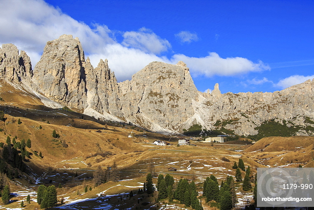 Blue sky on the rocky peaks and typical autumn landscape at Gardena Pass, South Tyrol, Trentino-Alto Adige, Italy, Europe
