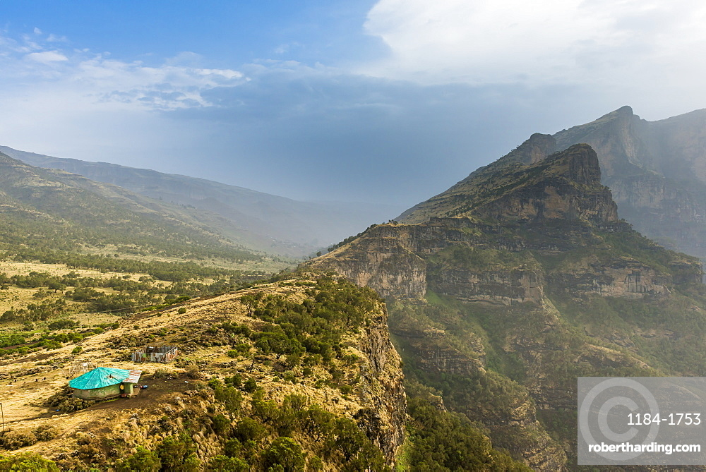 Community house on the edge of a cliff, Simien Mountains National Park, UNESCO World Heritage Site, Debarq, Ethiopia, Africa