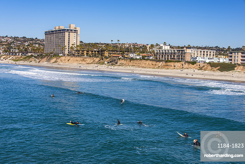 Surfers waiting in the waters of La Jolla for the next big wave, California, United States of America, North America