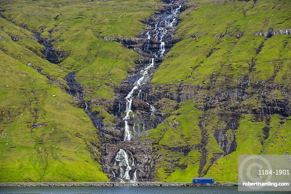 Waterfall tumbling down the hill, Streymoy, Faroe Islands, Denmark, Europe