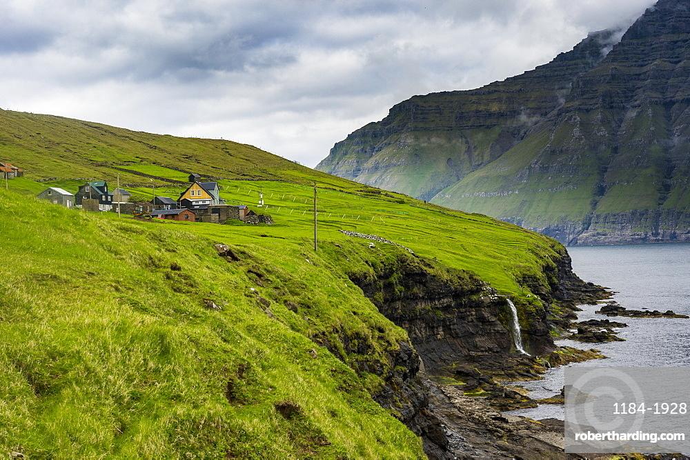 Waterfall into the ocean, Bordoy, Faroe Islands, Denmark, Europe
