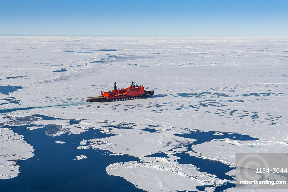 Aerial of the Icebreaker '50 years of victory' on its way to the North Pole breaking through the ice, Arctic
