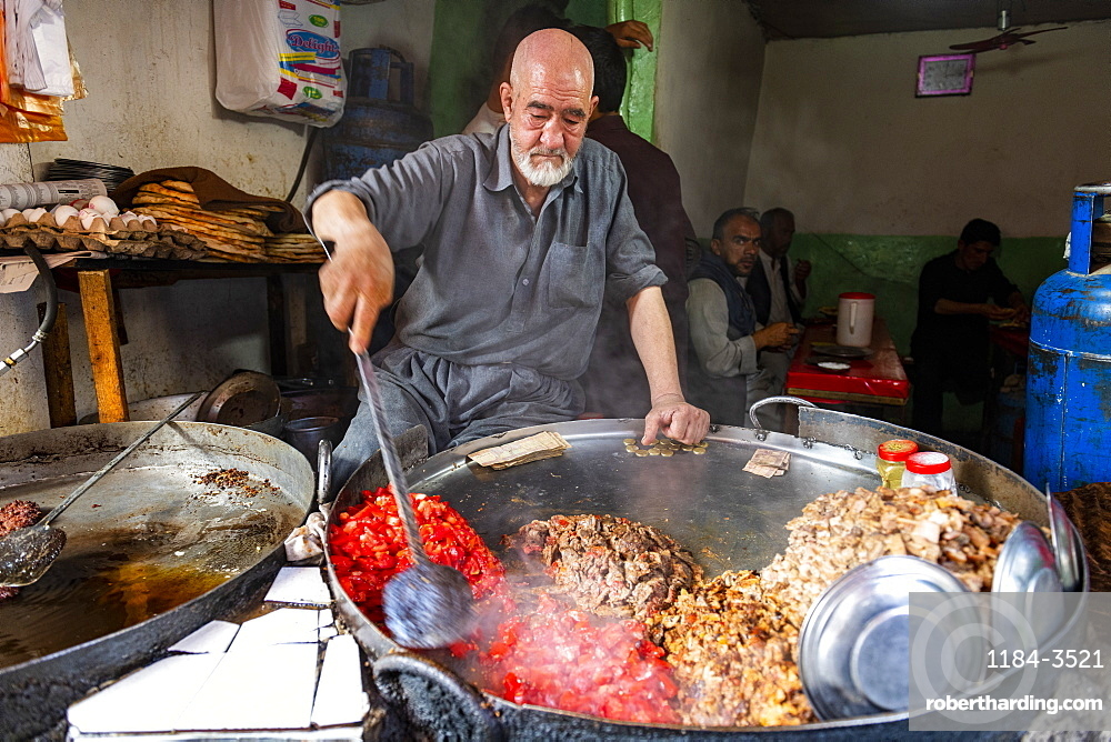 Man cooking food in a giant pot, Bird Street, Kabul, Afghanistan, Asia