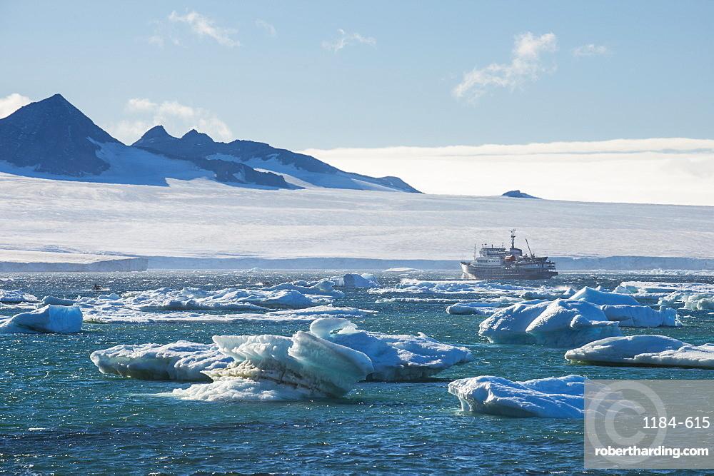 Cruise ship behind icebergs, Brown Bluff, Tabarin Peninsula, Antarctica, Polar Regions