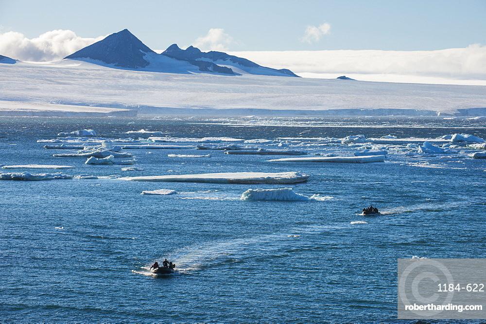 Zodiac with tourists cruising through the icebergs, Brown Bluff, Tabarin Peninsula, Antarctica, Polar Regions