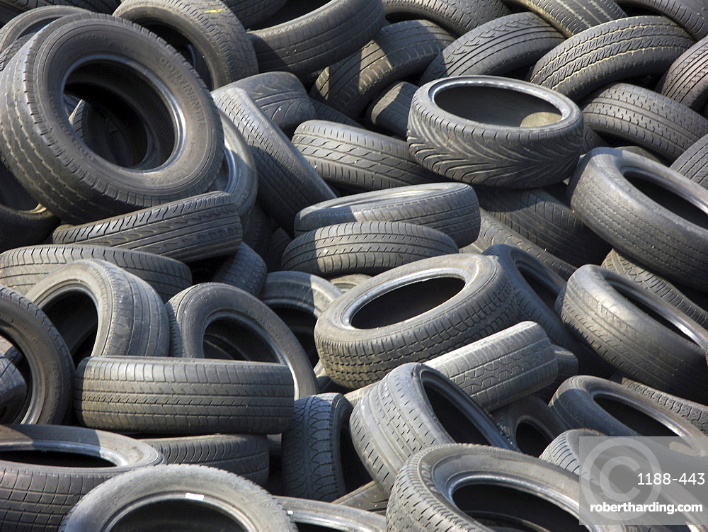 Uk. Used tyres piling up at a recycling centre in tower hamlets, london, england.