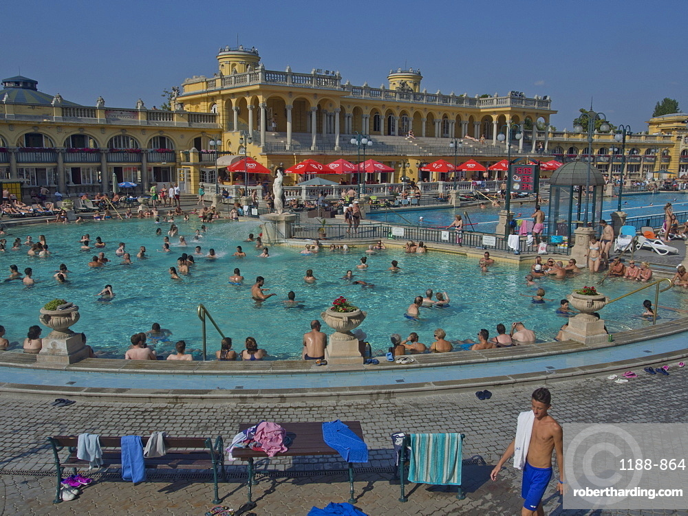 People enjoy the outdoor pools at the Szechenyi Thermal Baths, Budapest, Hungary, Europe