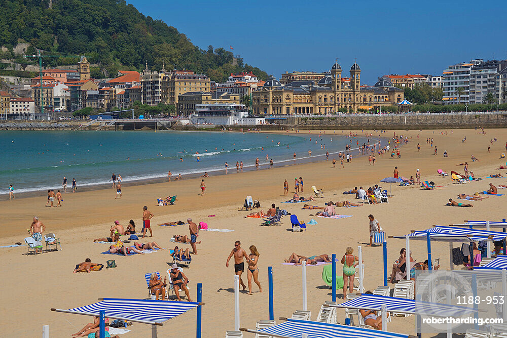 People enjoy the seaside at La Concha beach in San Sebastian,Basque Country,Euskadi,Spain