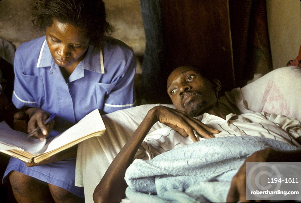 Uganda patient being cared for by mobile nurse nsambye hospital, kampala