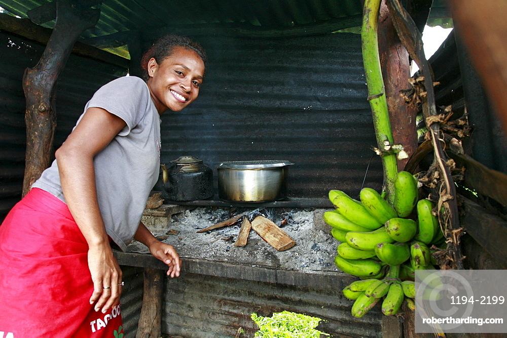 Fiji paulini mateyawa, 23, in kitchen, qelena village, taveuni photo by sean sprague