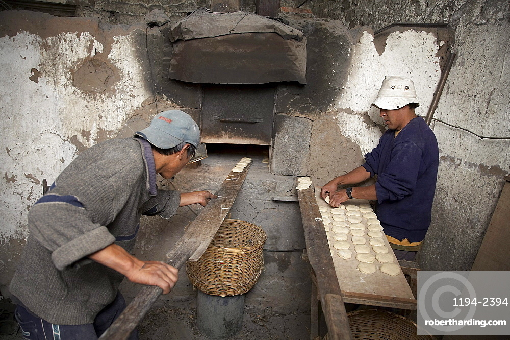 Peru. Making bread on wood fired oven, colca canyon