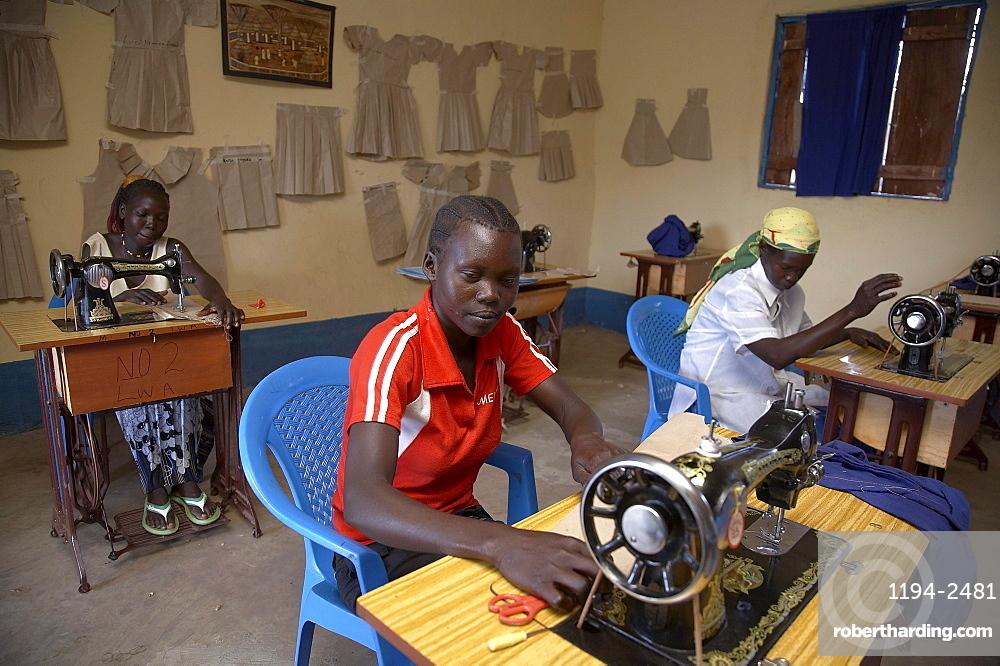 South sudan loka womens association. tailoring workshop. women using sewing machines
