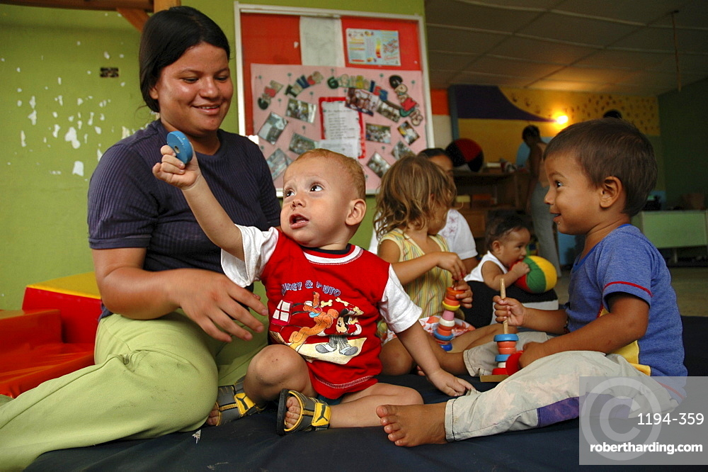 Colombia mother relating to her children at a day care and child stimulation center run by dni (international defence of children) in barrancabermeja