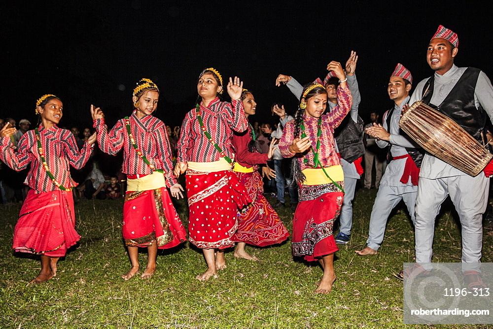 Nepali girls wearing chaubandi cholo (blouse) and fariya (skirt) dancing to the tunes of Nepali folk songs, Assam, India, Asia