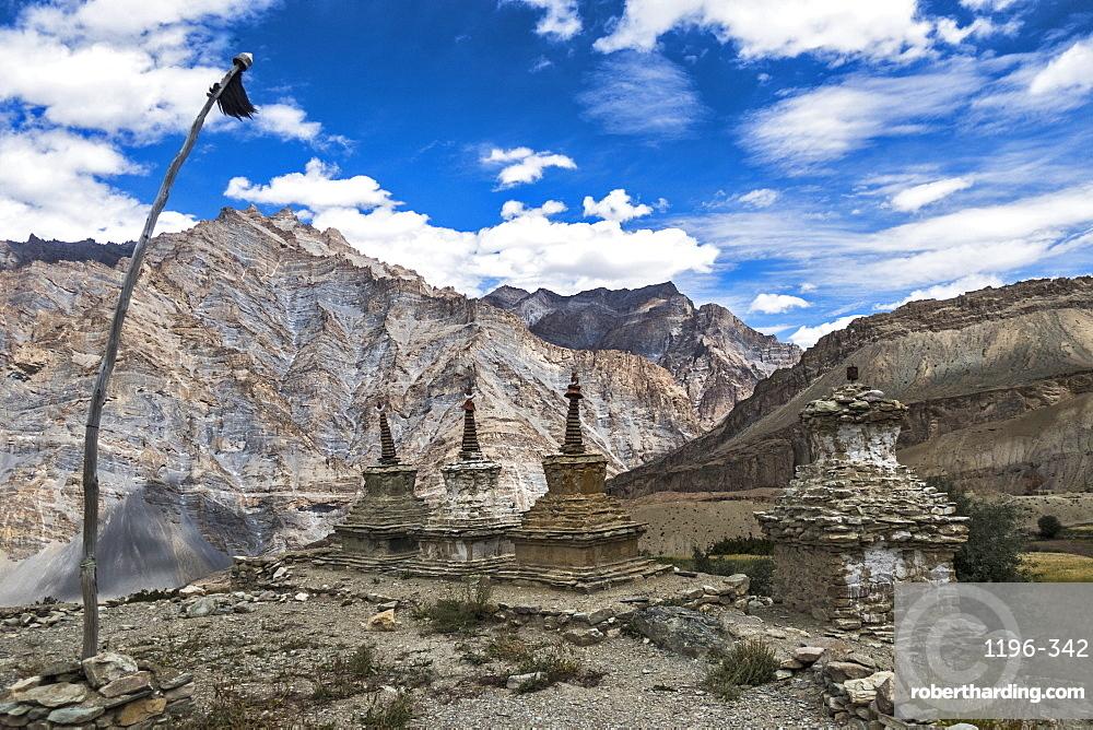 Weathered Buddhist chortens at Neyrak village looking over cliff, Zanskar, India, Himalayas, Asia