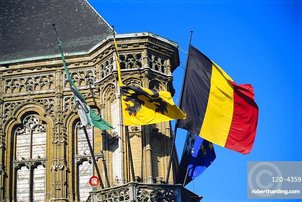 Flags of Belgium on the right, Flanders in the center on the town hall of Ghent, Flanders, Belgium