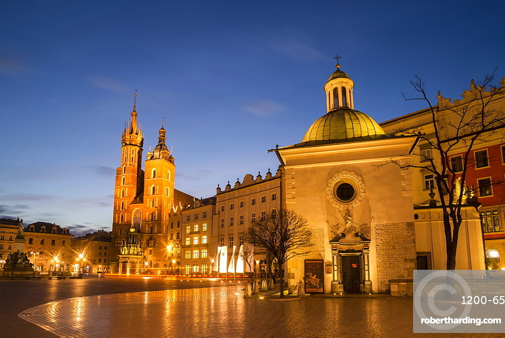 St. Mary's Church (St. Marys Basilica) and main square illuminated at dawn, UNESCO World Heritage Site, Krakow, Poland, Europe