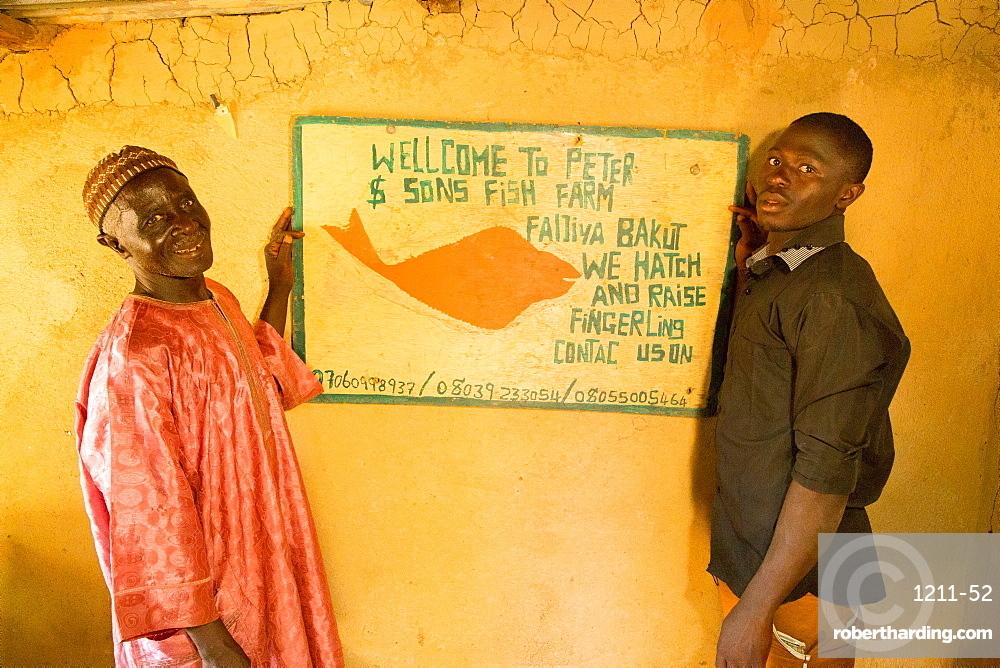 Baba Peter Keita and son Richard Peter, run a fish farm, Nigeria, West Africa, Africa