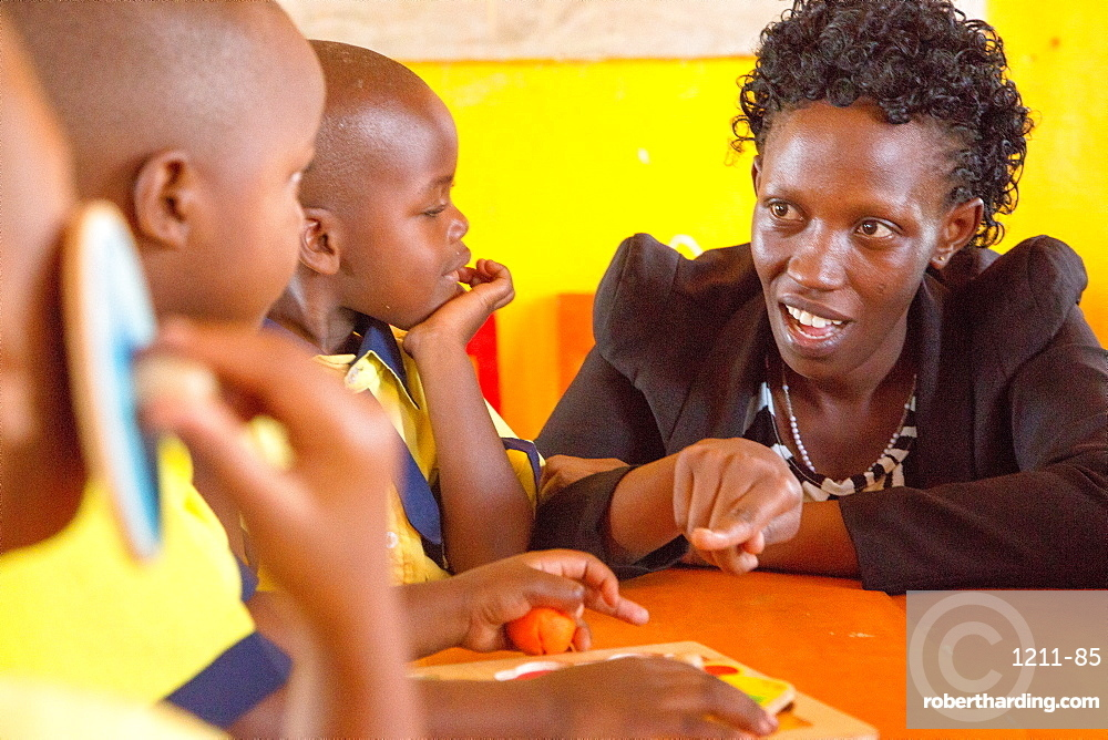 Agnes Mbvoyire, VSO national volunteer working alongside Filipino volunteer Rhea Villarico to improve standards of teaching in nursery schools in eastern Rwanda, Africa