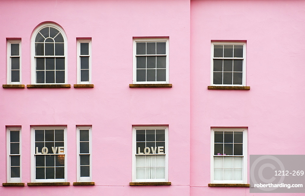 Pink house with love signs in the window, United Kingdom, Europe