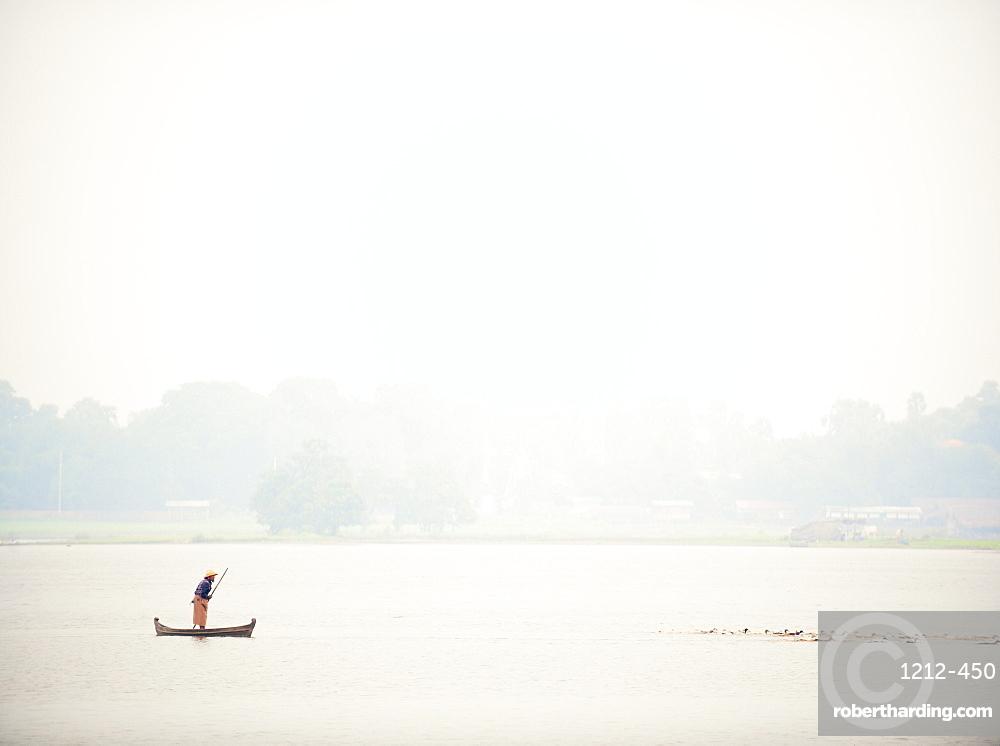 Fisherman at the U Bein Bridge, Taungthaman Lake, Amarapura near Mandalay, Myanmar (Burma), Asia