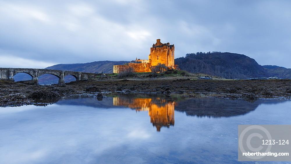 Dusk at Eilean Donan (Eilean Donnan) Castle in Dornie, Highlands, Scotland, United Kingdom, Europe