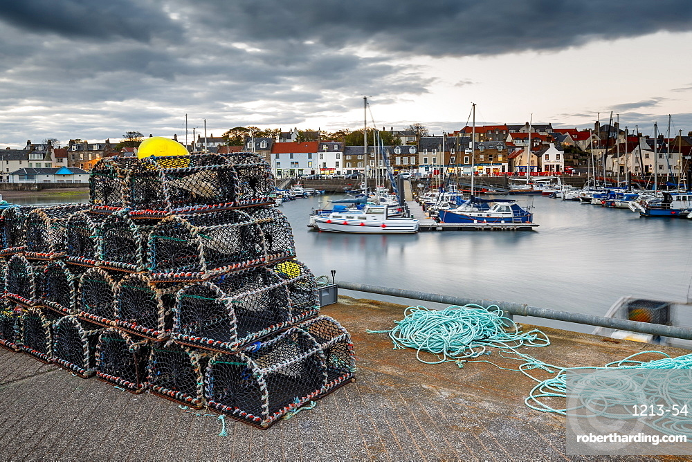 Sailing boats and crab pots at dusk in the harbour at Anstruther, Fife, East Neuk, Scotland, United Kingdom, Europe