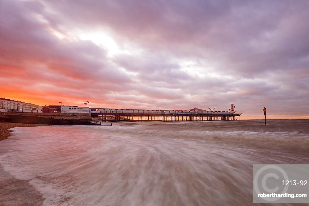 Dramatic skies over Herne Bay Pier at dusk, Herne Bay, Kent, England, United Kingdom, Europe