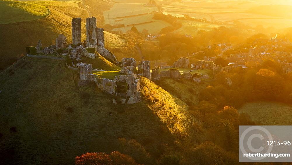 Golden sunrise over the village and castle at Corfe, Dorset, England, United Kingdom, Europe