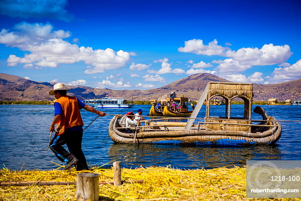 Quechua Indian family on Floating Grass islands of Uros, Lake Titicaca, Peru, South America