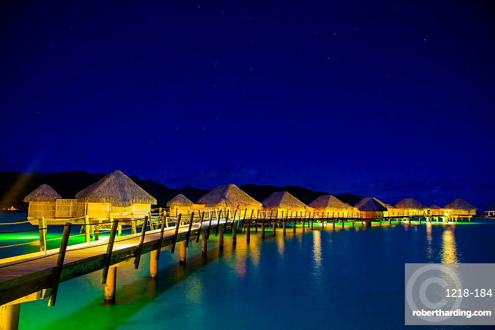 Overwater bungalows at night, Le Taha'a Resort, Tahiti, French Polynesia, South Pacific, Pacific