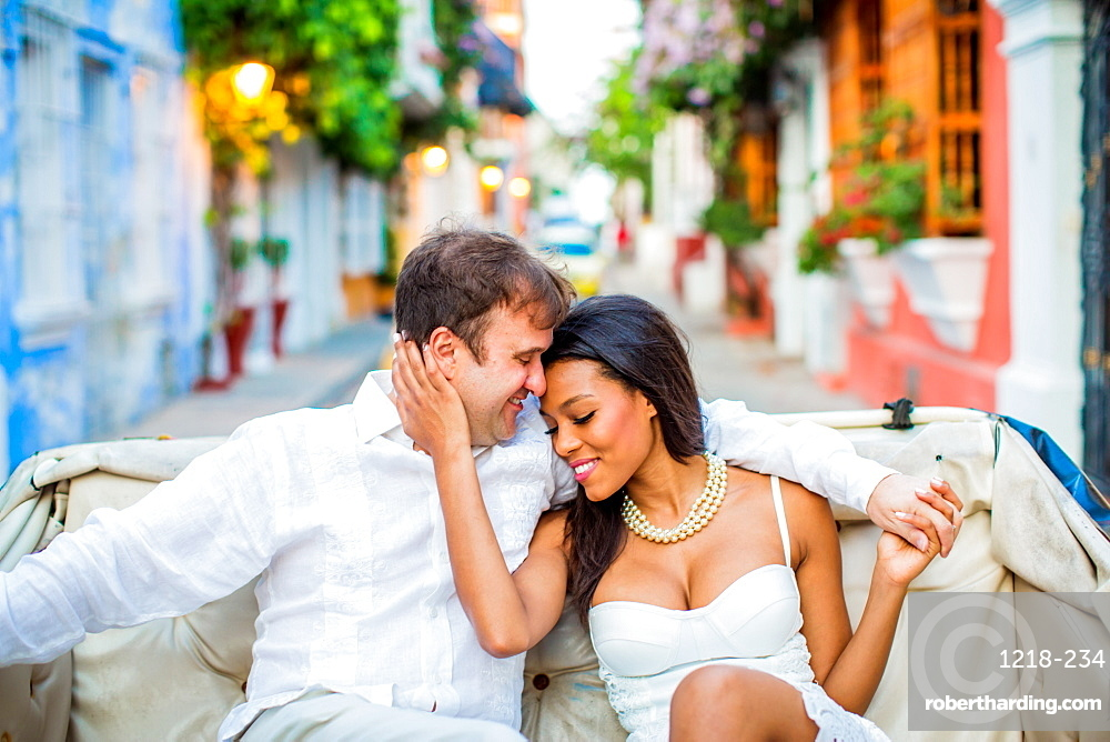 Couple sitting in a horse and carriage, Old Walled-in City, Cartagena, Colombia, South America
