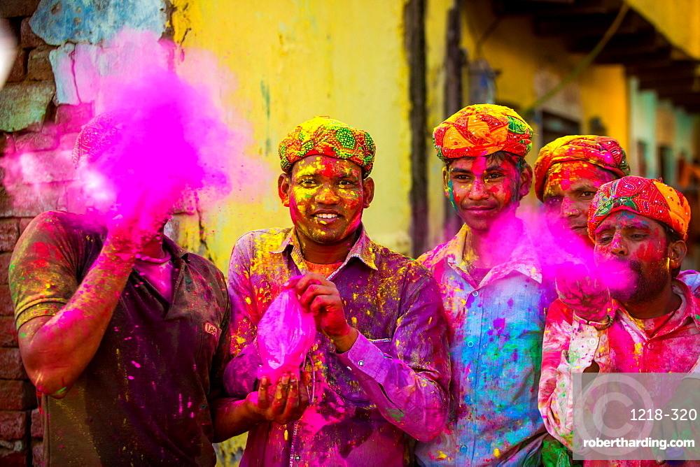 Men throwing colored pigment, Holi Festival, Vrindavan, Uttar Pradesh, India, Asia