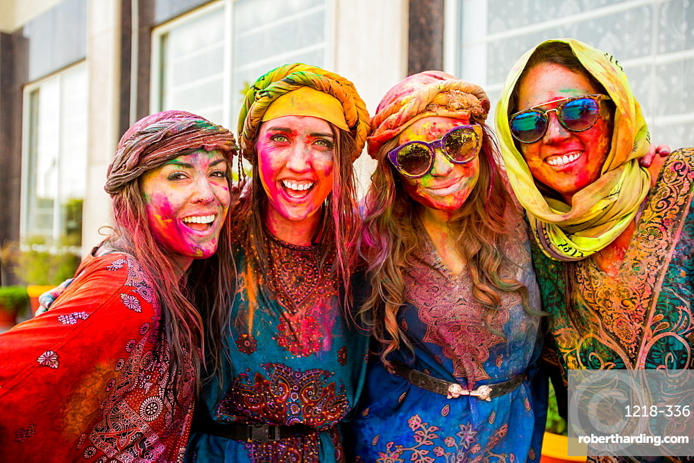 Tourists covered in pigment during the Holi Festival, Vrindavan, India, Asia