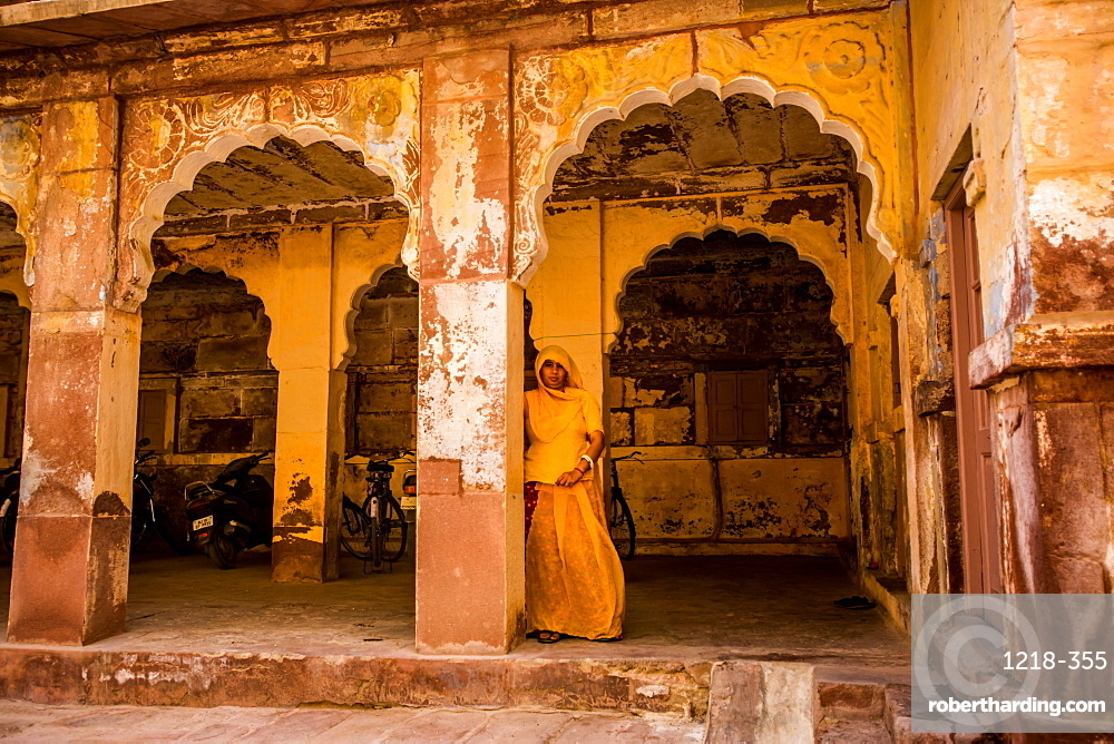Woman hiding in the entranceway of Mehrangarh Fort in Jodhpur, the Blue City, Rajasthan, India, Asia