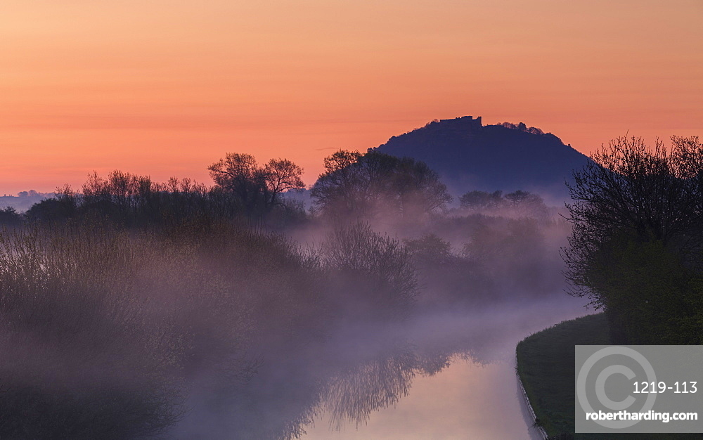 Mist lingers among the trees along the Shropshire Union canal as it snakes its way through the Cheshire plain to Beeston Castle, Cheshire, England, United Kingdom, Europe