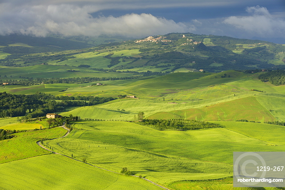 Looking across the Val d'Orcia to the historic towns of Rocca d'Orcia and Castiglione d'Orcia with clouds lingering beyond, UNESCO World Heritage Site, Tuscany, Italy, Europe