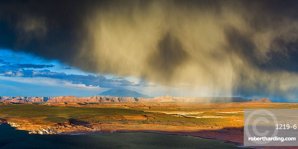 Storm passes across Navajo Mountain just before sunset, Page, Arizona, United States of America, North America