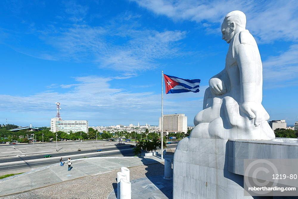 A statue of Jose Marti looks down onto the Plaza de la Revolucion in the Vedado area of Havana, Cuba, West Indies, Caribbean, Central America