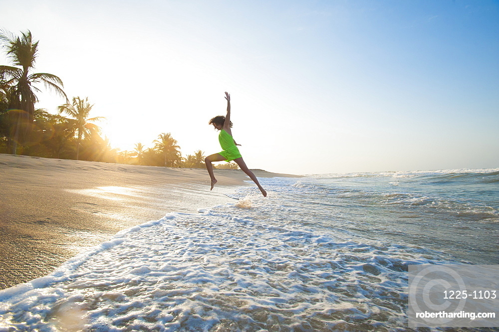 A girl plays in the waves at Palomino on the Caribbean coast of Colombia, South America